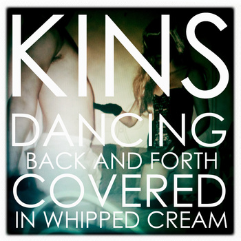 Kins : Dancing back and forth covered in whipped cream